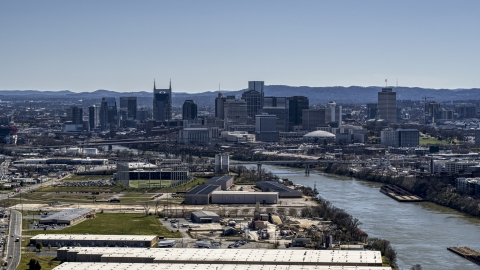 DXP002_112_0006 - Aerial stock photo of The city's skyline by the Cumberland River in Downtown Nashville, Tennessee