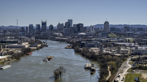 DXP002_112_0007 - Aerial stock photo of A barge on the river and the city's skyline, Downtown Nashville, Tennessee
