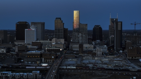 DXP002_115_0002 - Aerial stock photo of Light reflecting off skyscrapers in city's skyline, seen from Church Street at twilight in Downtown Nashville, Tennessee