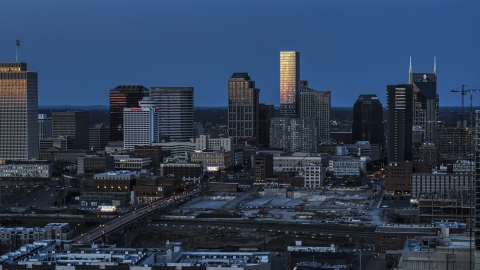 DXP002_115_0004 - Aerial stock photo of The city's skyline at twilight in Downtown Nashville, Tennessee