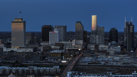 DXP002_115_0005 - Aerial stock photo of A view of light reflecting off skyscrapers in city's skyline, seen from near Church Street at twilight in Downtown Nashville, Tennessee