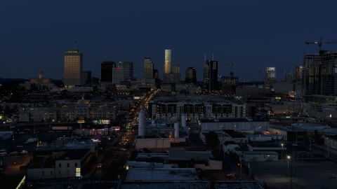 DXP002_115_0009 - Aerial stock photo of A wide view of skyscrapers reflecting light in the city skyline at twilight in Downtown Nashville, Tennessee