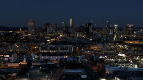 DXP002_115_0012 - Aerial stock photo of A wide view of city skyline at twilight, near high-rise construction, Downtown Nashville, Tennessee