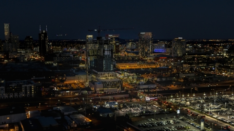 DXP002_115_0017 - Aerial stock photo of A high-rise building under construction at night, Downtown Nashville, Tennessee