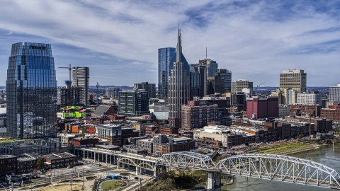 DXP002_116_0004 - Aerial stock photo of AT&T Building near bridge and Cumberland River in Downtown Nashville, Tennessee