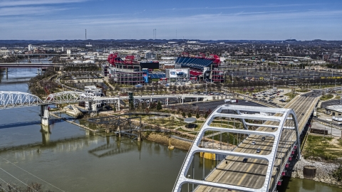 DXP002_116_0008 - Aerial stock photo of Nissan Stadium seen from a bridge in Nashville, Tennessee