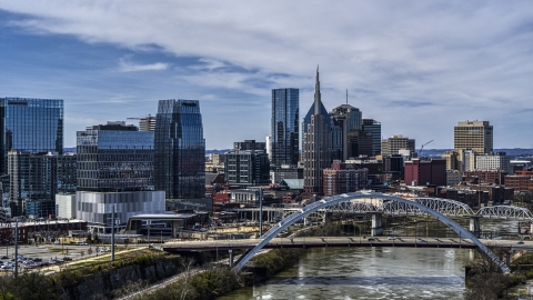 DXP002_116_0010 - Aerial stock photo of Office high-rise and skyscrapers seen from river and bridge in Downtown Nashville, Tennessee