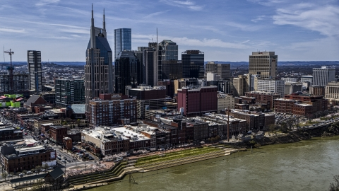 DXP002_117_0004 - Aerial stock photo of The city's skyline overlooking the Cumberland River, Downtown Nashville, Tennessee