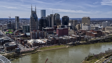 DXP002_117_0005 - Aerial stock photo of The city's skyline overlooking the Cumberland River, Downtown Nashville, Tennessee