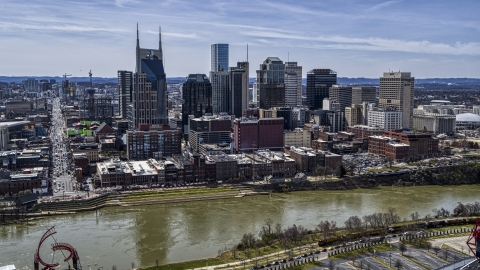 DXP002_117_0006 - Aerial stock photo of A view of city's skyline across the Cumberland River, Downtown Nashville, Tennessee