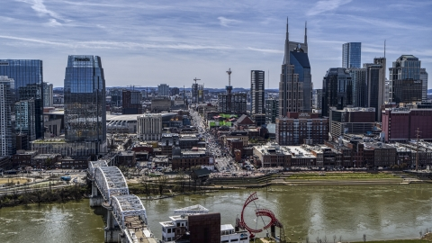 DXP002_117_0007 - Aerial stock photo of A view of Broadway across the Cumberland River, Downtown Nashville, Tennessee