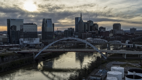 DXP002_119_0007 - Aerial stock photo of The city's skyline and bridges over the Cumberland River at sunset, Downtown Nashville, Tennessee