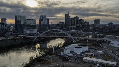 DXP002_119_0008 - Aerial stock photo of City skyline by bridges and Cumberland River at sunset, Downtown Nashville, Tennessee