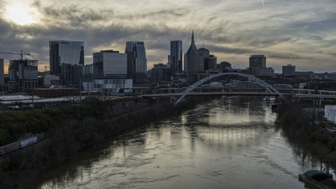 DXP002_119_0011 - Aerial stock photo of The city's skyline, bridges over the Cumberland River at sunset, Downtown Nashville, Tennessee