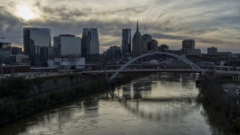 DXP002_119_0012 - Aerial stock photo of City skyline, bridges spanning the Cumberland River at sunset, Downtown Nashville, Tennessee