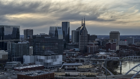 DXP002_120_0002 - Aerial stock photo of Riverfront skyscrapers by the Cumberland River at sunset, Downtown Nashville, Tennessee