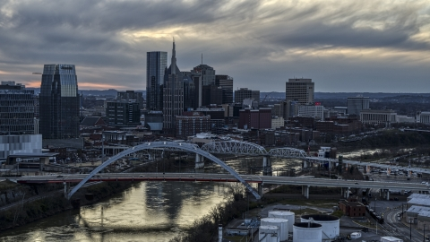 DXP002_120_0007 - Aerial stock photo of The riverfront skyline, two bridges, and the Cumberland River at sunset, Downtown Nashville, Tennessee