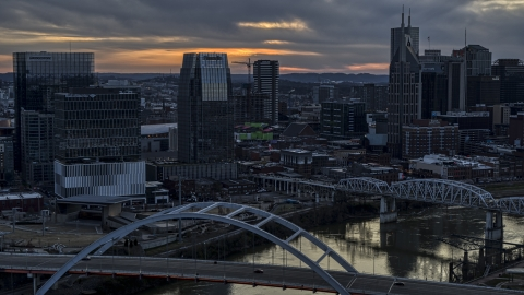 DXP002_120_0010 - Aerial stock photo of The Pinnacle skyscraper and a bridges on the river at sunset, Downtown Nashville, Tennessee