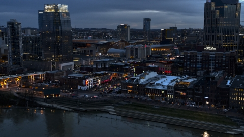 DXP002_120_0013 - Aerial stock photo of Riverfront buildings, cars on Broadway at twilight, Downtown Nashville, Tennessee