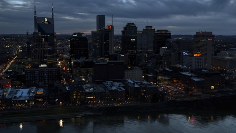 DXP002_120_0018 - Aerial stock photo of A group of skyscrapers at twilight on the other side of the river, Downtown Nashville, Tennessee