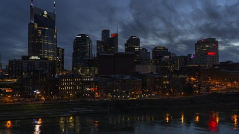 DXP002_121_0001 - Aerial stock photo of The city's skyline at twilight seen from the river, Downtown Nashville, Tennessee
