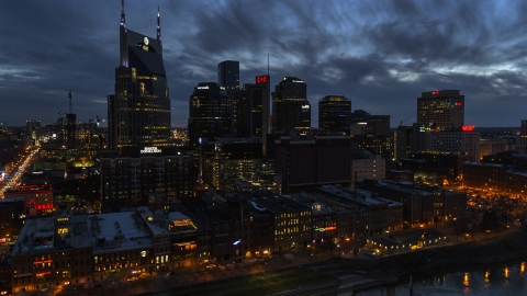 DXP002_121_0002 - Aerial stock photo of Clouds above the city's skyline at twilight, Downtown Nashville, Tennessee
