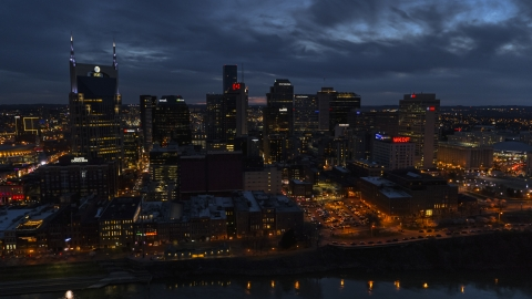 DXP002_121_0003 - Aerial stock photo of AT&T Building and the city's skyline at twilight, seen from Cumberland River, Downtown Nashville, Tennessee