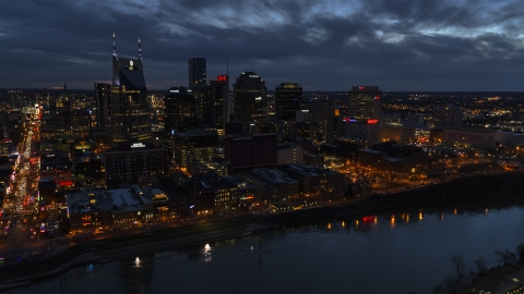 DXP002_121_0004 - Aerial stock photo of A view across the river toward the city's skyline at twilight, Downtown Nashville, Tennessee