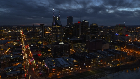 DXP002_121_0005 - Aerial stock photo of The AT&T Building skyscraper and city skyline at twilight, Downtown Nashville, Tennessee