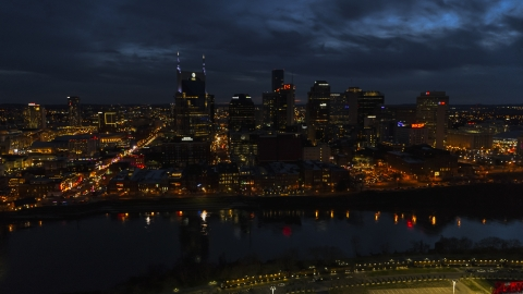 DXP002_121_0009 - Aerial stock photo of Tthe AT&T Building and skyline at twilight on the other side of the river, Downtown Nashville, Tennessee