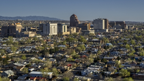 DXP002_122_0004 - Aerial stock photo of A view of the city's high-rises from neighborhoods, Downtown Albuquerque, New Mexico