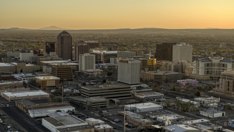 DXP002_122_0008 - Aerial stock photo of A view of high-rise office buildings at sunset, Downtown Albuquerque, New Mexico