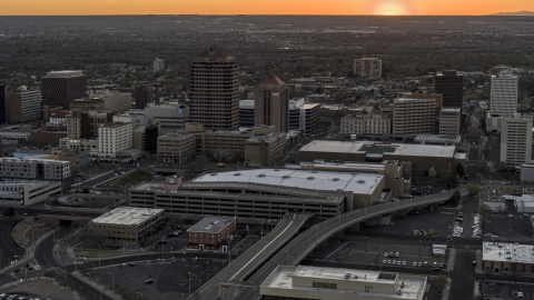 DXP002_122_0010 - Aerial stock photo of Office high-rises and convention center near office tower and shorter hotel tower at sunset, Downtown Albuquerque, New Mexico