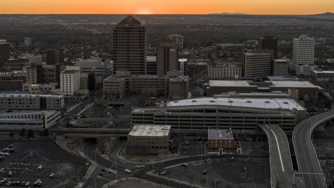 DXP002_122_0011 - Aerial stock photo of Office tower and shorter hotel tower behind convention center at sunset, Downtown Albuquerque, New Mexico