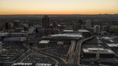 DXP002_123_0003 - Aerial stock photo of Albuquerque Plaza and Hyatt Regency at sunset near office high-rises, Downtown Albuquerque, New Mexico