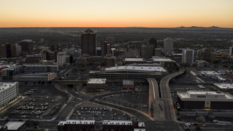 DXP002_123_0004 - Aerial stock photo of Albuquerque Plaza, Hyatt Regency, office high-rises at sunset in Downtown Albuquerque, New Mexico