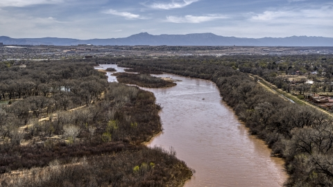 DXP002_124_0006 - Aerial stock photo of The Rio Grande, small islands in the river in Albuquerque, New Mexico
