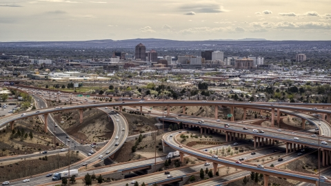 DXP002_126_0003 - Aerial stock photo of Downtown Albuquerque seen from freeway interchange traffic, New Mexico