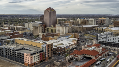 DXP002_127_0002 - Aerial stock photo of Albuquerque Plaza high-rise and neighboring city buildings, Downtown Albuquerque, New Mexico