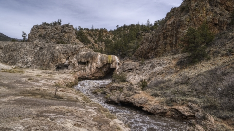 DXP002_129_0001 - Aerial stock photo of Rapids flowing through a rock formation in the mountains of New Mexico