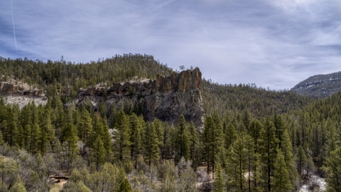 DXP002_129_0006 - Aerial stock photo of A rock formation in the mountains in New Mexico