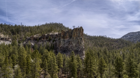 DXP002_129_0007 - Aerial stock photo of A view of a rock formation in the mountains in New Mexico
