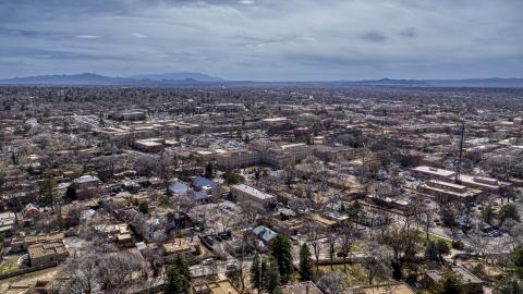 DXP002_129_0010 - Aerial stock photo of The downtown area and surrounding city of Santa Fe, New Mexico