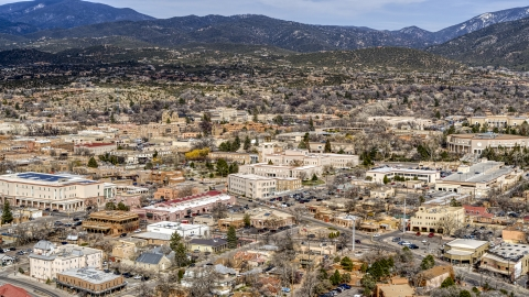 DXP002_130_0003 - Aerial stock photo of Bataan Memorial Building and city buildings in Santa Fe, New Mexico