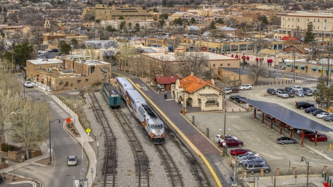 DXP002_130_0007 - Aerial stock photo of A passenger train at the station in Santa Fe, New Mexico
