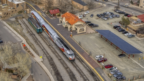 DXP002_130_0008 - Aerial stock photo of A view of a passenger train at the station in Santa Fe, New Mexico, tilt to top of the train