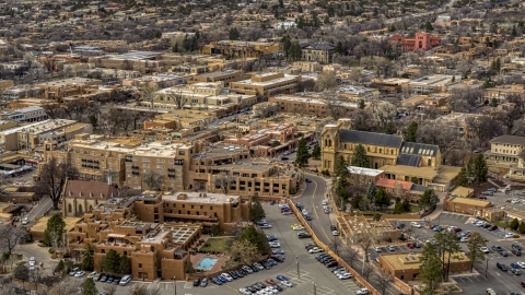 DXP002_130_0011 - Aerial stock photo of Two hotels and a cathedral in Santa Fe, New Mexico