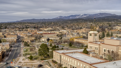 DXP002_131_0007 - Aerial stock photo of Downtown seen from tower and flags on Bataan Memorial Building, Santa Fe, New Mexico