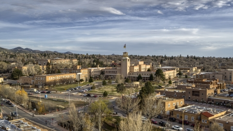 DXP002_131_0014 - Aerial stock photo of The front of the Bataan Memorial Building in Santa Fe, New Mexico