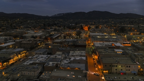 DXP002_132_0004 - Aerial stock photo of The cathedral lit up at night at the end of San Francisco Street, Santa Fe, New Mexico